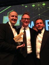 Four celebrate award win with client Tesco